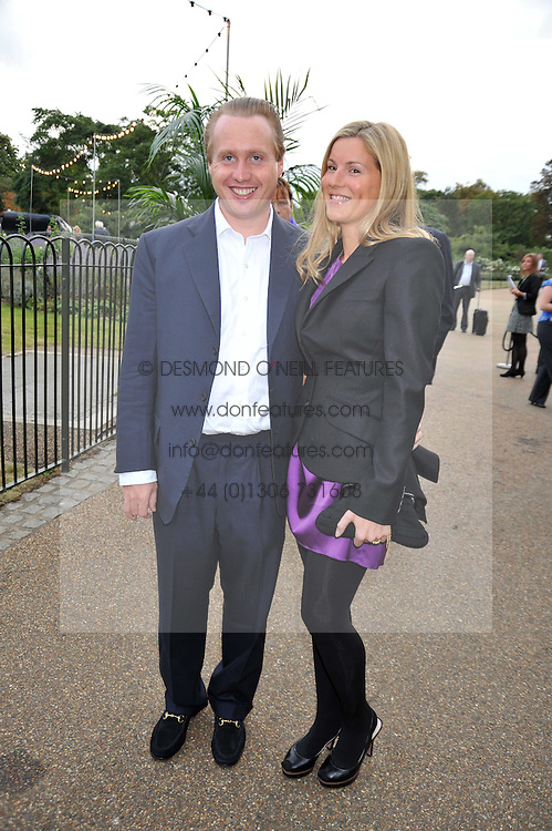 JOE BAMFORD and his wife ALEX at the unveiling of 'Isis' a sculpture by Simon Gudgeon hosted by the Royal Parks Foundation and the Halcyon Gallery by the banks of The Serpentine, Hyde Park, London on 7th September 2009.
