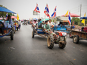 21 FEBRUARY 2014 - KHLONG CHIK, PHRA NAKHON SI AYUTTHAYA, THAILAND: Farmers' tractors block Highway 32 near Bang Pa In in Phra Nakhon Si Ayutthaya province. About 10,000 Thai rice farmers, traveling in nearly 1,000 tractors and farm vehicles closed the road. The farmers were traveling to the airport in Bangkok to protest against the government because they haven't been paid for rice the government bought from them last year. The farmers turned around and went home after they met with government officials who promised to pay the farmers next week. This is the latest blow to the government of Yingluck Shinawatra which is confronting protests led by anti-government groups, legal challenges from the anti-corruption commission and expanding protests from farmers who haven't been paid for rice the government bought.    PHOTO BY JACK KURTZ