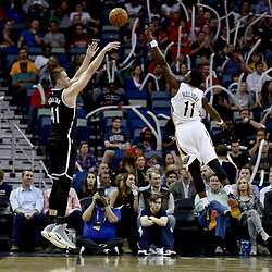 Jan 20, 2017; New Orleans, LA, USA; Brooklyn Nets center Justin Hamilton (41) shoots over New Orleans Pelicans guard Jrue Holiday (11) during the first quarter of a game at the Smoothie King Center. Mandatory Credit: Derick E. Hingle-USA TODAY Sports