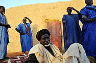 Village elders discuss a potential water management project in the village of Boitieck Ehel Aly in Mauritania. Just a few decades ago, the majority of Mauritanian society were nomadic herdsmen. While many Mauritanians remain mobile, communities have become increasingly sedentary, relying on agriculture for survival. Prolonged and severe drought caused by climate change has caused wide spread food insecurity. Failed rainy seasons and hunger have forced many working aged men in rural areas to migrate to the cities and abroad in search of work, leaving only women, children and the elderly to work the land, cultivate food and tend to livestock in rural villages. <br />