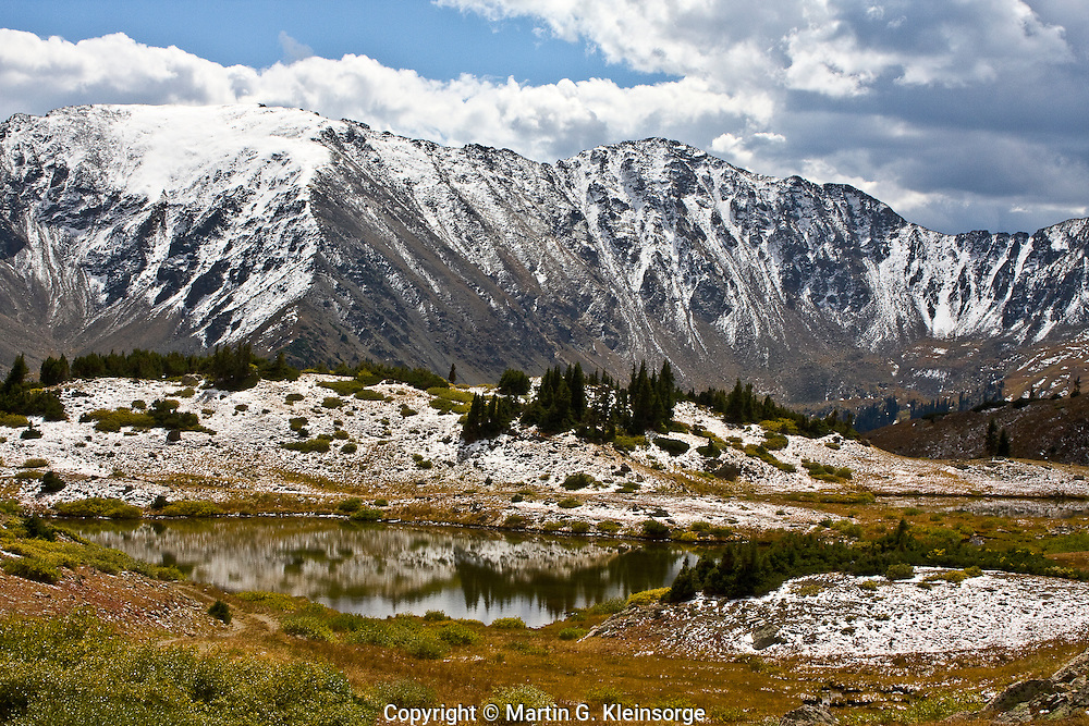 First snow of the autumn season on 13,201 ft. Lenawee Mountain along the Continental Divide.   Viewed from Loveland Pass, Colorado.