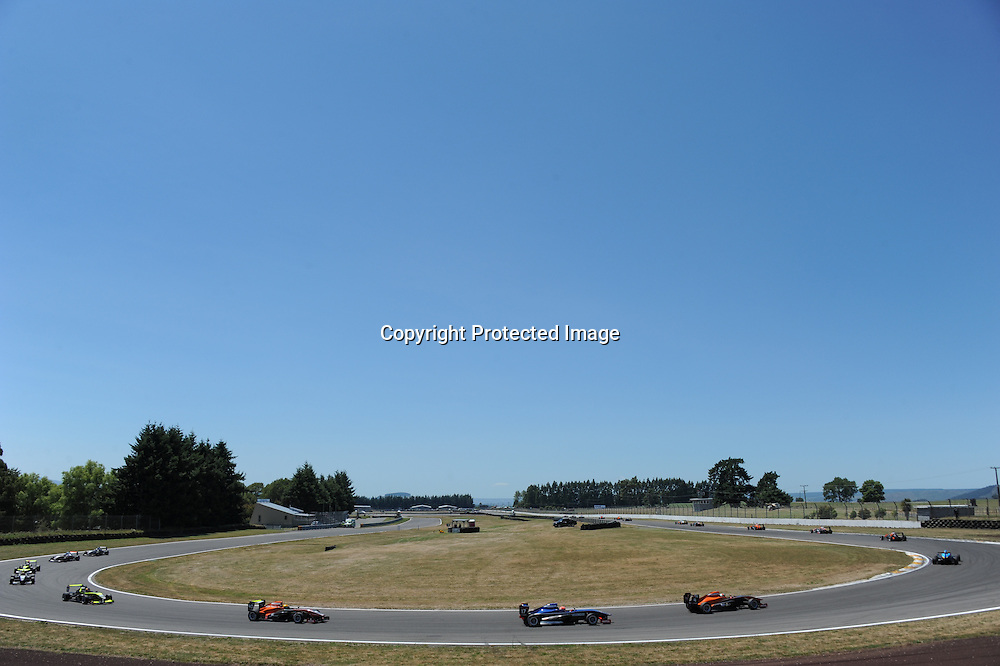 The field of TRS cars turn into the back straight during the racing at Taupo on Sunday Feb 8 2015