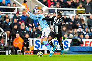 Kyle Walker (#2) of Manchester City and Allan Saint-Maximin (#10) of Newcastle United battle for possession of the ball during the Premier League match between Newcastle United and Manchester City at St. James's Park, Newcastle, England on 30 November 2019.