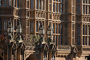 Exterior of windows, lanterns and architecture of the Palace of Westinster, the seat of the British parliament and where its MPs work, on 17th January 2017, in London England. The old Palace of Westminster was largely destroyed by fire on the night of 16 October 1834 and its replacement was built in a Neo-gothic style, completed in 1858 and is one of the most prominent symbols of both London and England.
