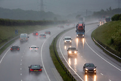 © Licensed to London News Pictures 25/06/2109, Cirencester, UK. Commuters tackle terrible conditions on the A417 outside Cirencester as torrential rain creates dangerous driving conditions. Photo Credit : Stephen Shepherd/LNP