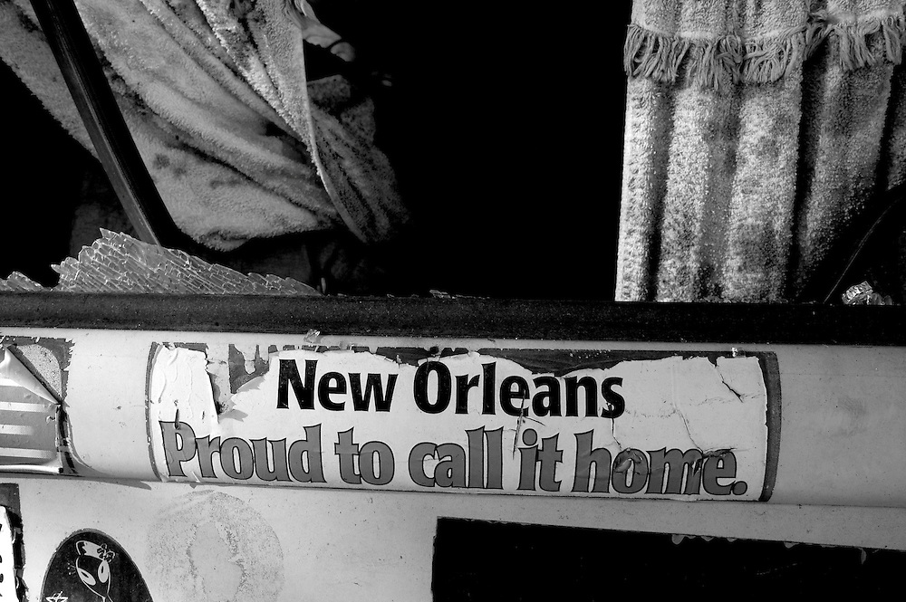 """A bumper sticker that reads """"New Orleans Proud to call it Home"""" is on the back of a destroyed van in New Orleans are nearly one month after Hurricanes' Katrina and Rita made land fall destroying most of the gulf coast Oct. 5, 2005. Darren Hauck"""