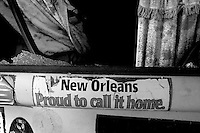 "A bumper sticker that reads ""New Orleans Proud to call it Home"" is on the back of a destroyed van in New Orleans are nearly one month after Hurricanes' Katrina and Rita made land fall destroying most of the gulf coast Oct. 5, 2005. Darren Hauck"