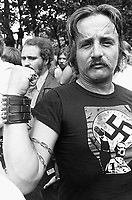 "09 Jul 1978, Chicago, Illinois, USA --- A man wears a t-shirt with an image of Hilter at a gathering of American Nazis. Protected by anti riot policy, Frank Collin, leader of the American Nazi movement and 20 of his followers met in Chicago.  In a 20 minute speech, Collin attacked the blacks and the Jews and talked of  1978 as the ""Year of the White Revolution.""  Several fights broke out in the crowd of observers and police made 50 arrests. USA. --- Image by © Owen Franken/CORBIS"