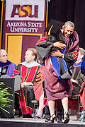 13 MAY 2009 -- TEMPE, AZ: President Obama speaks and congratulates students during the ASU commencement Wednesday night. President Barack Obama addressed the Arizona State University class of 2009 during the commencement program in Sun Devil Stadium in Tempe Wednesday evening.  PHOTO BY JACK KURTZ
