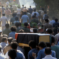 A funeral procession for a victim of a car bomb in Beirut, Lebanon in 1981.