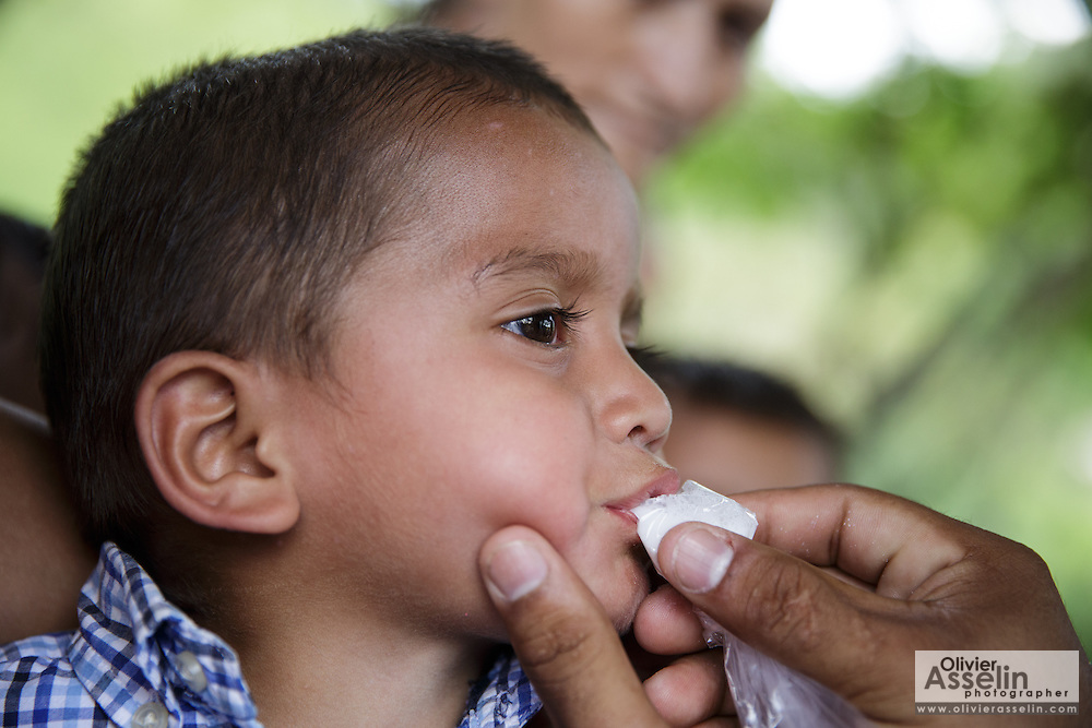 A boy takes deworming medicine during a vaccination session at the primary school in the town of Coyolito, Honduras on Wednesday April 24, 2013.
