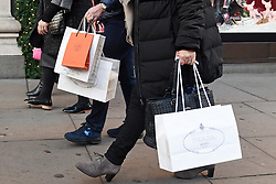 "File photo dated 04/12/16 of shoppers. Retail sales exceeded expectations to pick up ""modestly"" as summer drew more shoppers to the high street, figures show."