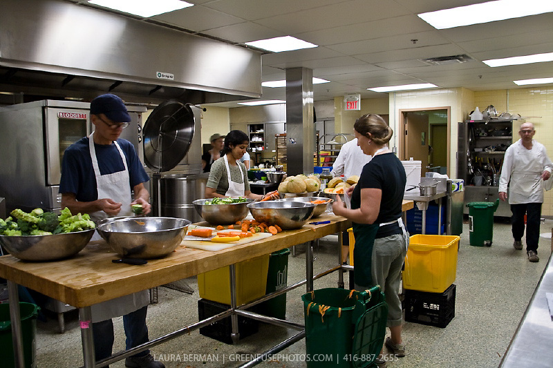 Cooks and volunteers prepare food in FoodShare's kitchen.