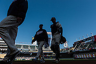 Joe Mauer #7 and Rick Anderson #40 of the Minnesota Twins head off the field before a game against the Detroit Tigers on April 3, 2013 at Target Field in Minneapolis, Minnesota.  The Twins defeated the Tigers 3 to 2.  Photo: Ben Krause
