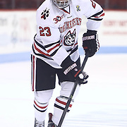 Colton Saucerman #23 of the Northeastern Huskies controls the puck during the game at Matthews Arena on January 18, 2014 in Boston, Massachusetts. (Photo by Elan Kawesch)