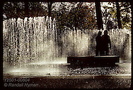 Young couple meeting in center of fountain at Missouri Botanical Garden in St. Louis. Missouri