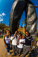 South African people with the 30 foot (9 meter) tall bronze statue of Nelson Mandela, Union Buildings in , Pretoria (Tshwane), South Africa.