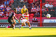 Peterborough United forward Ivan Toney (17) and Doncaster Rovers midfielder Jon Taylor (10) in action during the EFL Sky Bet League 1 match between Doncaster Rovers and Peterborough United at the Keepmoat Stadium, Doncaster, England on 21 September 2019.