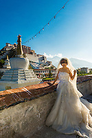 A Chinese bride posing in front of the Potala Palace, Lhasa, Tibet (Xizang), China.