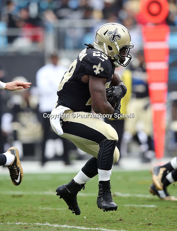 New Orleans Saints running back Khiry Robinson (29) runs the ball during the 2015 NFL week 3 regular season football game against the Carolina Panthers on Sunday, Sept. 27, 2015 in Charlotte, N.C. The Panthers won the game 27-22. (©Paul Anthony Spinelli)