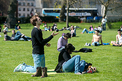 © Licensed to London News Pictures. 01/05/2013. London, UK. People enjoy the May sunshine in Green Park on May 1, 2013 in London. After the coldest start to spring for more than 50 years, forecasters say the sunshine and warm weather has finally arrived in London.Photo credit : Peter Kollanyi/LNP