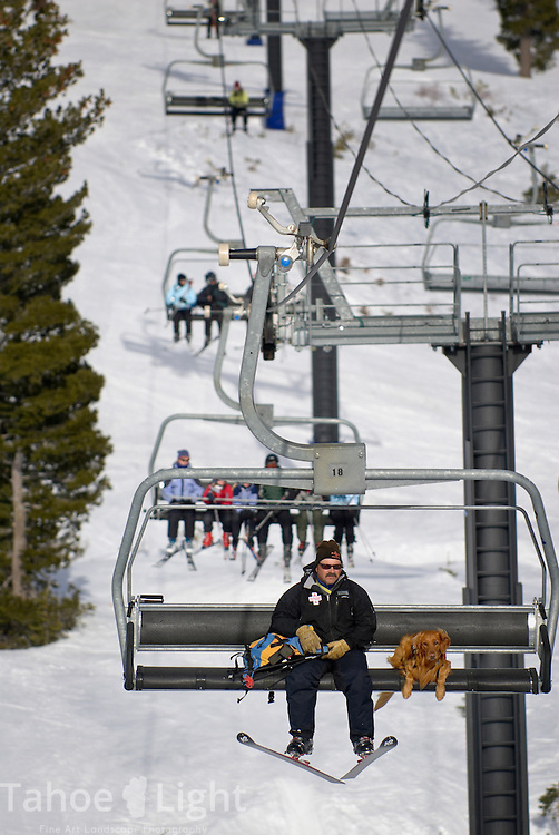 Assistant Ski Patrol Director Brian Slusser rides the Summit lift with his dog Shooter at Alpine Meadows ski resort on the North Shore of Lake Tahoe, Wednesday, February 21, 2007.