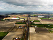 Nederland, Noord-Holland, Gemeente Wieringermeer, 16-04-2012. Wieringermeerpolder, overzicht langs zichtas van de Hooge Kwelvaart (een van de hoofdvaarten van de polder). Rechts windmolens langs de Robbenoordweg...Wieringmeer polder,  newly created land 1927, part of the Zuiderzee Works.luchtfoto (toeslag), aerial photo (additional fee required);.copyright foto/photo Siebe Swart