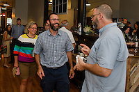 Gregory Butler assistant pastor at Grace Capital Church and Jim Daubenspeck of Daub's Cobbler Shop chat over coffee during Fusions's networking event at Wayfarer Coffee Roasters on Tuesday morning.  (Karen Bobotas/for the Laconia Daily Sun)