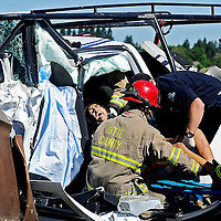 A woman is extracted from the back of a truck after being involved in a two-vehicle accident on Highway 70 north of Marysville on Thursday, June 27, 2013. The drivers of both vehicles were killed in the accident, while the woman and another passenger were transported to Rideout Memorial Hospital. (Nate Chute/Appeal-Democrat)
