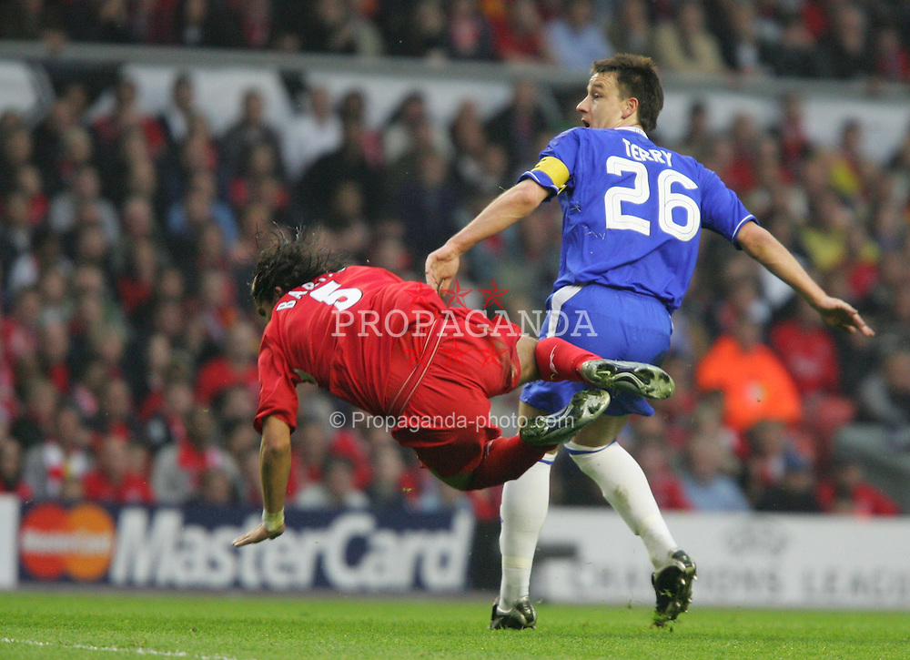 LIVERPOOL, ENGLAND. TUESDAY, MAY 3rd, 2005: Liverpool's Milan Baros and Chelsea's John Terry during the UEFA Champions League Semi Final 2nd Leg at Anfield. (Pic by David Rawcliffe/Propaganda)