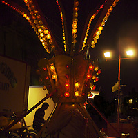 A small fair ground ride at night