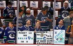 June 10, 2011; Vancouver, BC, CANADA; Fans of the Vancouver Canucks hold up signs in support of goalie Roberto Luongo (not pictured) before game five of the 2011 Stanley Cup Finals against the Boston Bruins at Rogers Arena. Mandatory Credit: Jason O. Watson / US PRESSWIRE