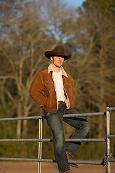 cowboy in a Marlboro jacket on a fence