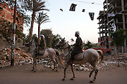 Supporters of Egyptian presidential candidate Amr Moussa ride Arab stallions to welcome the candidate before the start of a May 16, 2012 campaign stop in the village of Khanka on the outskirts of Cairo, Egypt. Moussa is currently the front-runner in the upcoming Egyptian presidential elections that will take place across the country May 23-24, 2012. (Photo by Scott Nelson)
