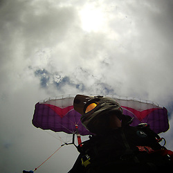Speedflyer Pedro Pimentel preparing for a barrel roll in a highwind session (40Km/h winds +) in Rhossili bay at the Gower Peninsula, Wales.
