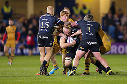 Matt Garvey (capt) of Bath Rugby is tackled by Jack Tovey of Bristol Rugby - Rogan Thomson/JMP - 20/10/2016 - RUGBY UNION - The Recreation Ground - Bath, England - Bath Rugby v Bristol Rugby - EPCR Challenge Cup.
