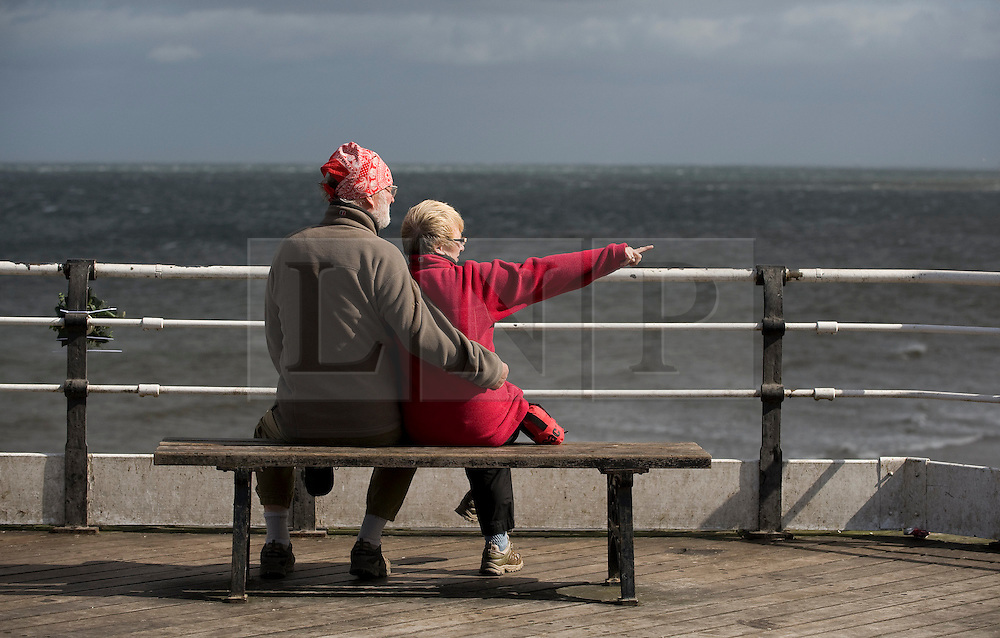© Licensed to London News Pictures. 12/09/2011..Saltburn Beach, Saltburn, Cleveland, England...A couple brave strong winds as they sit at the end of the pier at Saltburn in Cleveland...Photo credit : Ian Forsyth/LNP