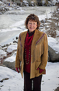 Denise Rue-Pastin, director of the Water Information Program in southwestern Colorado stands for a portrait along the San Juan River in Pagosa Springs, Colorado.