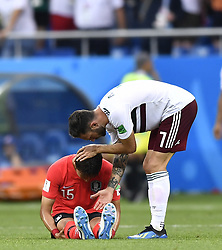 ROSTOV-ON-DON, June 23, 2018  Miguel Layun (R) of Mexico comforts Jung Wooyoung of South Korea after the 2018 FIFA World Cup Group F match between South Korea and Mexico in Rostov-on-Don, Russia, June 23, 2018. Mexico won 2-1. (Credit Image: © Chen Yichen/Xinhua via ZUMA Wire)
