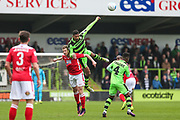 Forest Green Rovers Ethan Pinnock(16) out jumps Wrexham's Jordan White(9) during the Vanarama National League match between Forest Green Rovers and Wrexham FC at the New Lawn, Forest Green, United Kingdom on 18 March 2017. Photo by Shane Healey.