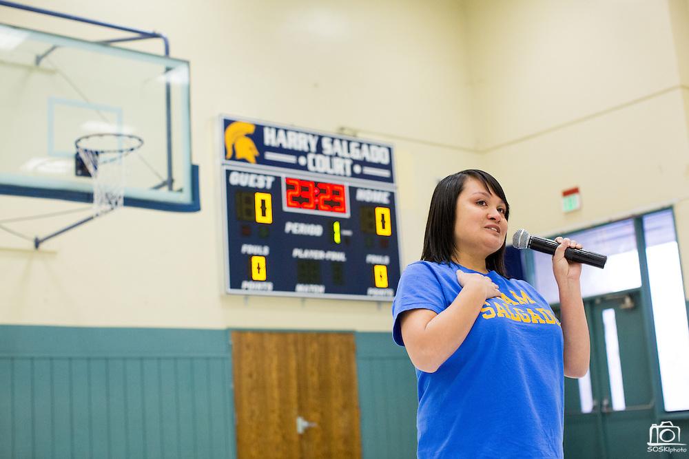 Teresa Salgado-Ellis remembers her father during the Harry Salgado scoreboard dedication ceremony at Sierramont Middle School in San Jose, California, on January 8, 2015. (Stan Olszewski/SOSKIphoto)