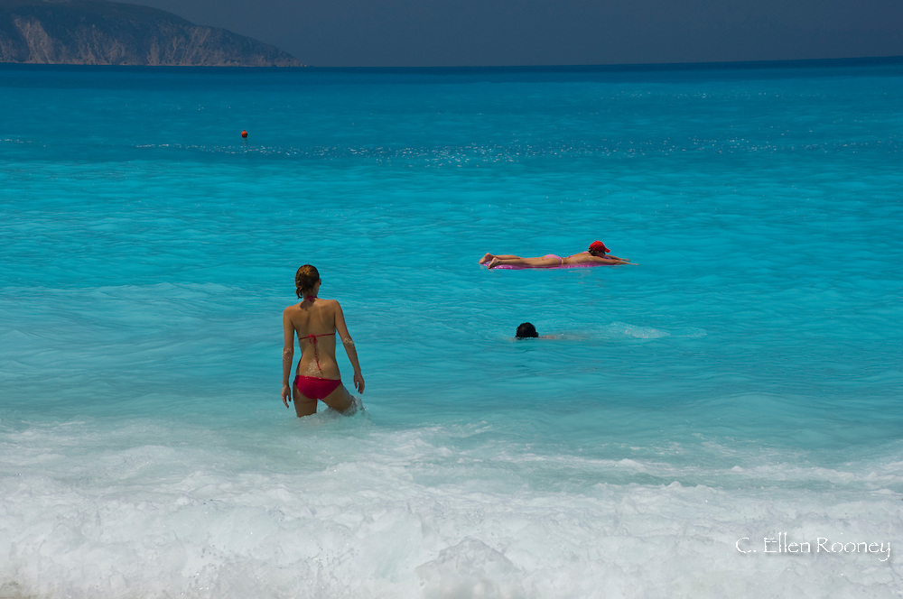 Bathers at Myrtos Beach, Kefalonia, The Ionian Islands, Greece