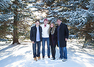 Sun twinkling on snow thorough fir trees in snowy landscape for a festive family picture holiday card.  Believe it or not it is downtown Niwot.