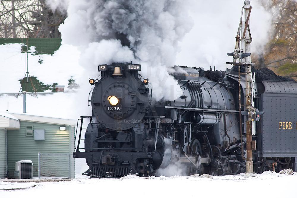 Photographs of the 1225 steam locomotive.