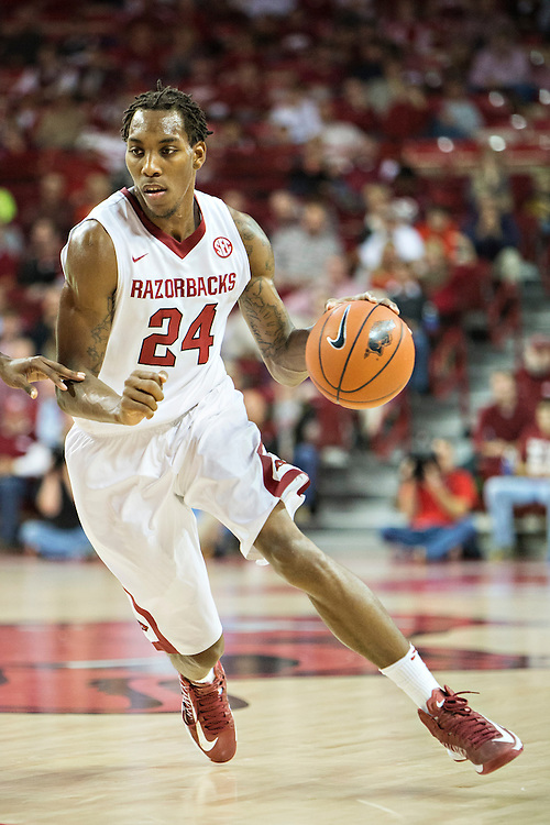 FAYETTEVILLE, AR - NOVEMBER 15:  Michael Qualls #24 of the Arkansas Razorbacks drives to the basket against the Louisiana Ragin' Cajuns at Bud Walton Arena on November 15, 2013 in Fayetteville, Arkansas.  The Razorbacks defeated the Ragin' Cajuns 76-63.  (Photo by Wesley Hitt/Getty Images) *** Local Caption *** Michael Qualls