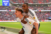 Fulham midfielder Tom Cairney (10)  and Fulham defender Ryan Sessegnon (3) celebrate after securing promotion to the Premier League during the EFL Sky Bet Championship play-off final match between Fulham and Aston Villa at Wembley Stadium, London, England on 26 May 2018. Picture by Jon Hobley.