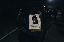 Oscar Grant poster on a backpack of a protester in Oakland, CA 2014