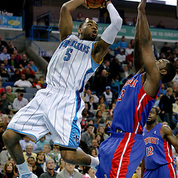 Dec 16, 2009; New Orleans, LA, USA;  New Orleans Hornets guard Marcus Thornton (5) shoots over Detroit Pistons guard Rodney Stuckey (3) during the first half at the New Orleans Arena. Mandatory Credit: Derick E. Hingle-US PRESSWIRE