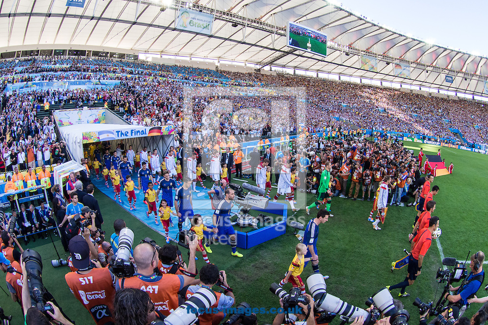 The German and Argentinian teams take to the field during the 2014 FIFA World Cup Final match at Maracana Stadium, Rio de Janeiro<br /> Picture by Andrew Tobin/Focus Images Ltd +44 7710 761829<br /> 13/07/2014