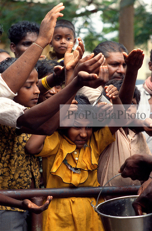 TAMIL NADU, MARCH 1994.Children are reaching out their hands to get some food.